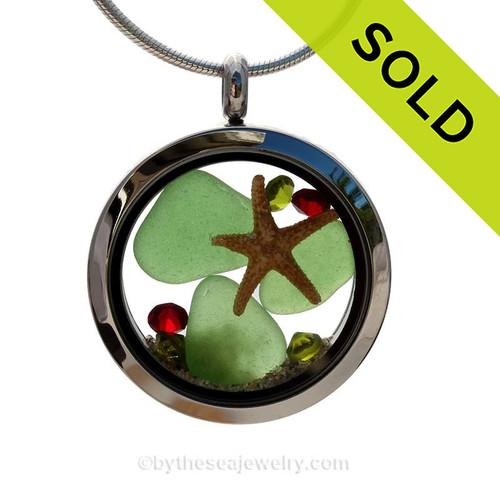 Green Genuine beach found sea glass and a real starfish and beach make this a great locket necklace for the holidays. Ruby and Peridot crystal gems finish the locket with some extra bling. SOLD - Sorry This Sea Glass Jewerly Selection Is NO LONGER AVAILABLE!