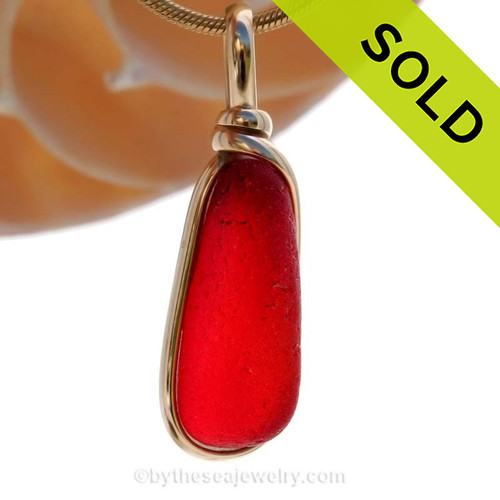Ultra rare vivid long teardrop shape red sea glass from Seaham England in our Original Wire Bezel© setting in 14K Rolled Gold. Sorry this rare Sea Glass Pendant has been SOLD!