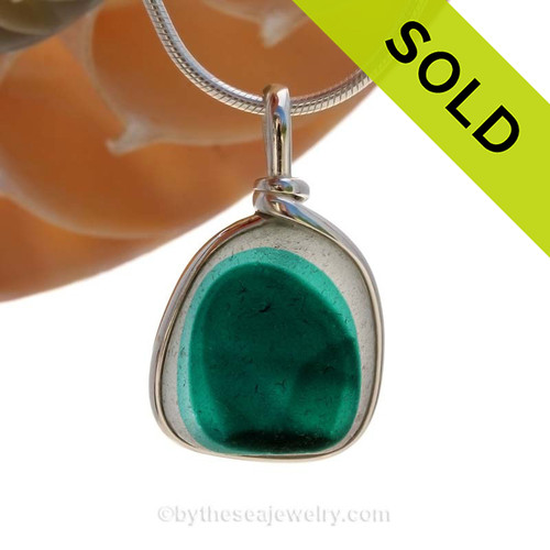 A BEAUTIFUL mixed teal green sea glass piece is set in our Original Sea Glass Bezel©  solid sterling pendant setting. Sorry this Sea Glass Jewelry selection has been SOLD!