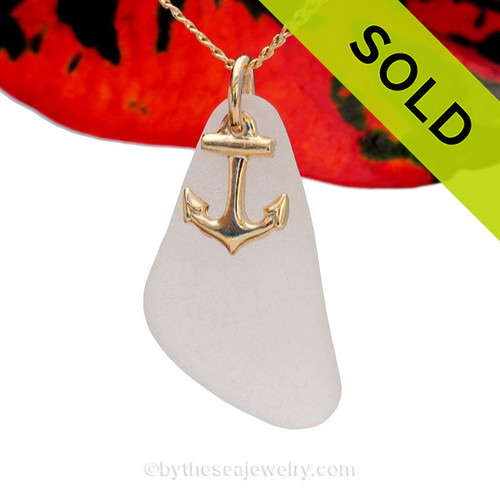 A perfect pure white sea glass piece is combined with a 14K goldfilled shell charm and comes WITH this 18 Inch 14K Goldifilled fine curb chain!