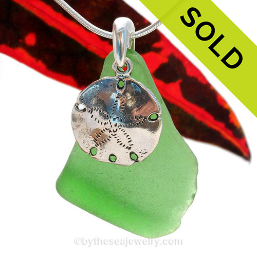 LARGE Green sea glass set on a solid sterling cast bail with a sterling silver Sandollar charm. Sorry this Genuine Sea Glass Necklace has been SOLD!
