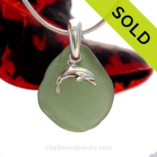 A rarer deep sea Green Sea Glass Necklace set on a solid sterling cast bail with a sterling silver dolphin charm. SOLD - Sorry this Sea Glass Jewelry selection is NO LONGER AVAILABLE!