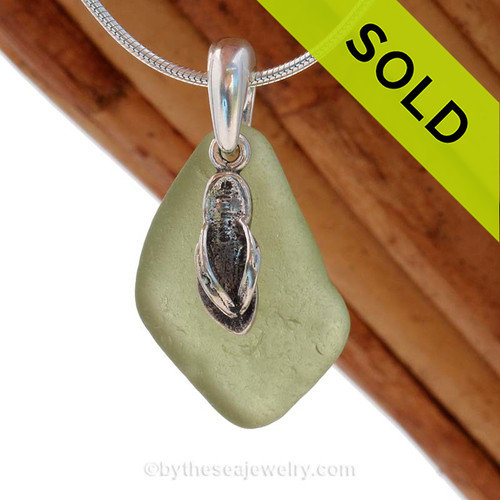 Perfect Peridot Green sea glass necklace set on a solid sterling cast bail with a sterling silver Flip Flop charm. SOLD - Sorry this  Rare Sea Glass Necklace is NO LONGER AVAILABLE!