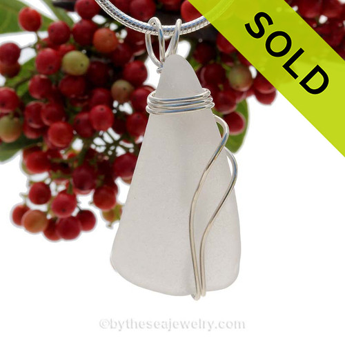 A large long piece of genuine sea glass in white and a triple solid sterling silver setting. This natural sea glass piece is TOTALLY UNALTERED from the way it was found on the beach. Sorry this Sea Glass Pendant has been SOLD!