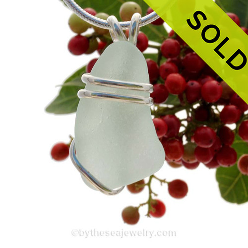 A thick but smaller piece of genuine sea glass pendant in seafoam green and a simple solid sterling silver setting. Sorry this piece of Sea Glass Jewelry has been SOLD!