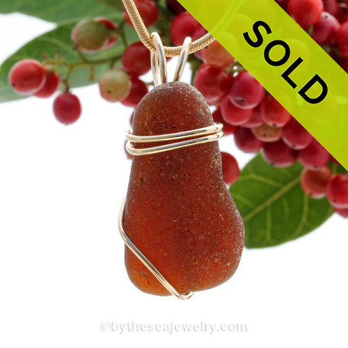 A frosty top quality piece of beach found Amber Brown Genuine Sea Glass in a Basic Beach wrapped 14K Goldfilled pendant setting. SOLD - Sorry this Sea Glass Pendant is NO LONGER AVAILABLE!