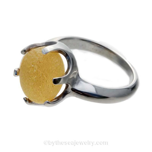 A stunning and perfect buttery yellow English sea glass piece set in a solid sterling silver ring.