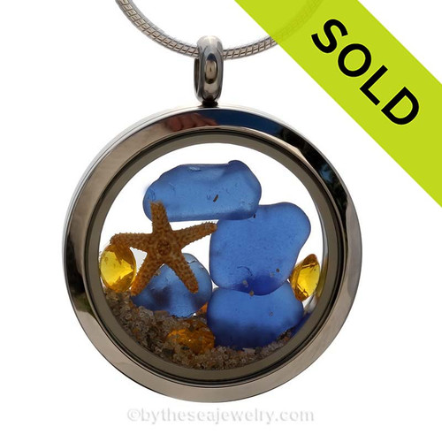 A great Sea Glass Locket for anyone, specially those with a November birthday. Cobalt blue sea glass combined with a real starfish and brightened up with a genuine Topaz crystal gems (November Birthstone). SOLD - Sorry this Sea Glass Jewelry selection is NO LONGER AVAILABLE!