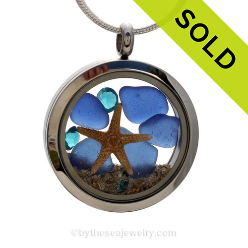 A beautiful pieces of Genuine beach found blue Sea Glass combined in a stainless steel locket necklace with a real starfish. Sorry this Sea Glass Jewelry piece has been SOLD!