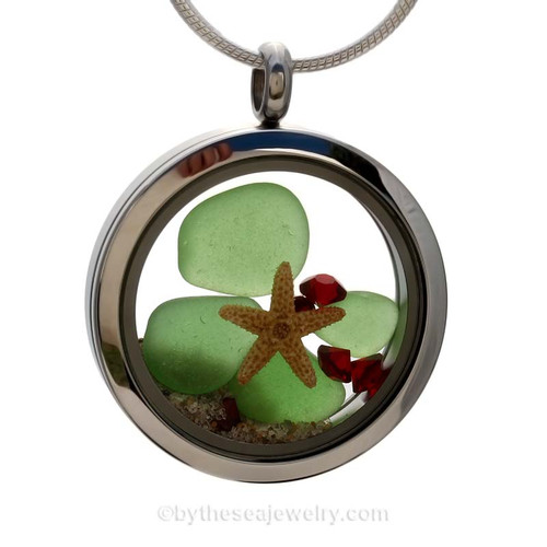 Green sea glass and a real starfish and beach make this a great locket necklace for the holidays. Ruby Red crystal gems finish the locket with some extra bling.