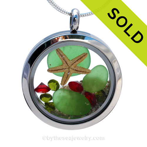 Green sea glass and vivid ruby red and peridot green gemstones make this a great locket necklace for the holidays.