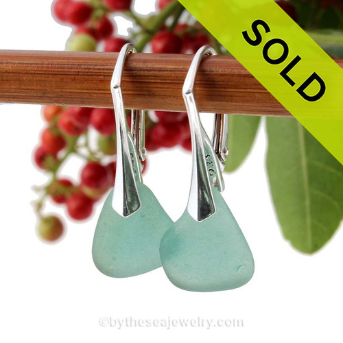 A pair of natural beach found Sea Glass Earrings in a Rare Aqua Green on Sterling Silver Leverbacks. Sorry this Sea Glass Jewelry selection has been SOLD!