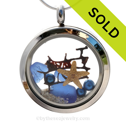 Natural beach found blue sea glass in a stainless steel locket with starfish and blue pearls. SOLD - Sorry this Sea Glass Jewelry selection is NO LONGER AVAILABLE!