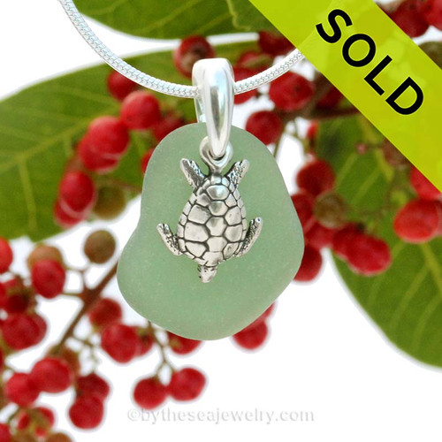 Unusual Green sea glass necklace set on a solid sterling cast bail with a sterling silver Turtle charm. Sorry this Sea Glass Jewelry selection has been SOLD!