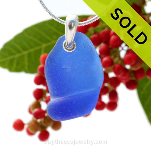 A neat  piece of ridged blue Sea Glass Necklace is combined on a solid sterling cast bail and presented on an 18 Inch solid sterling snake necklace chain. Sorry this Sea Glass Jewelry selection has been SOLD!