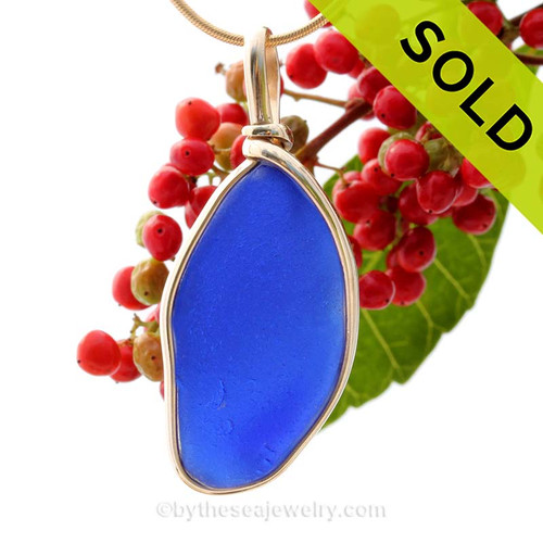 Our Original Wire Sea Glass Pendant Bezel© Setting setting really makes this glow! This piece is an intense cobalt blue with a heavy frost. SOLD - Sorry this Sea Glass Jewelry selection is NO LONGER AVAILABLE!