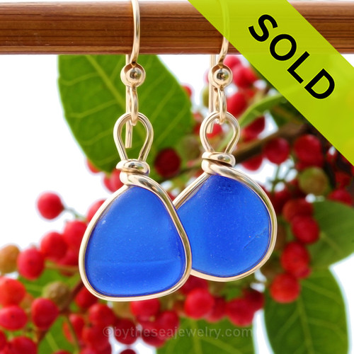 Vivid petite cobalt blue sea glass pieces set in our Original Wire Bezel© setting. Sorry these Sea Glass Earrings are no longer available.