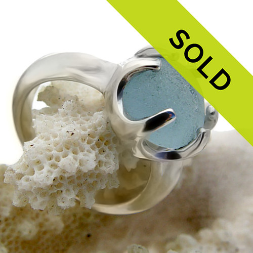 A great natural piece of genuine sea glass in a bright blue hue on a solid sterling 6 prong ring setting. Sorry this piece of Seaham English sea glass jewelry is no longer available.
