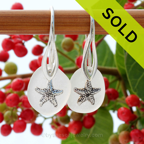 Natural beach found green sea glass pieces are set with solid sterling starfish charms and are presented on sterling silver Deco Hook earrings. Sorry these Sea Glass Earrings are No Longer Available.