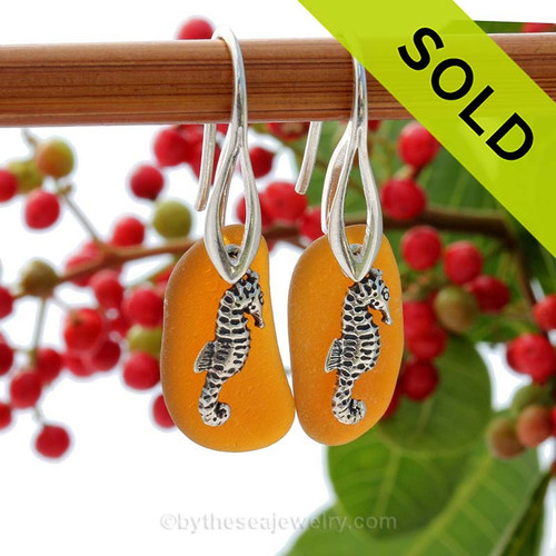 A perfect matched pair of beautiful amber brown Sea Glass Earrings combined with solid sterling seahorse  charms and a setting that leaves much of the beauty of these sea glass pieces shine. SOLD - Sorry this Sea Glass Jewelry selection is NO LONGER AVAILABLE!