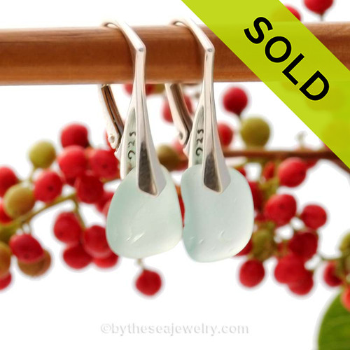 A pair of natural beach found Sea Glass Earrings in a Pale Aqua Blue on Sterling Silver Leverbacks.