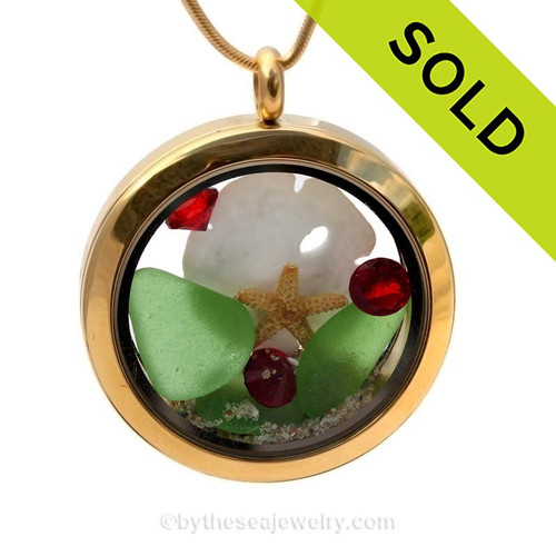 Bright green beach found sea glass combined with a real sandollar and starfish and finished with vivid red crystals and beach sand make this a great sea glass locket for the holidays! Sorry this Sea Glass Jewelry selection has been SOLD!