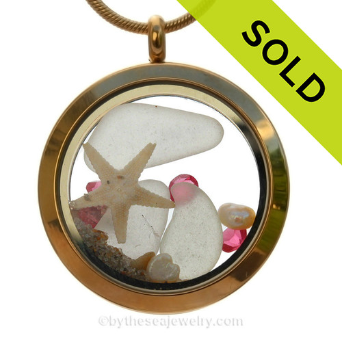 A gold tone stainless steel locket necklace with pure white beach found sea glass pieces and a real starfish and finished with Pink Tourmaline crystal gems. SOLD - Sorry this Sea Glass Locket is NO LONGER AVAILABLE!