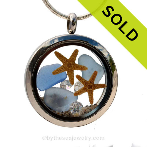 A beautiful pieces of natural Carolina blue sea glass combined in a stainless steel locket necklace with a real starfish and Stunning  crystal gems. SOLD - Sorry this Sea Glass Locket is NO LONGER AVAILABLE!