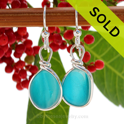 Super Ultra Rare Mixed Electric Aqua sea glass pieces from Seaham England are set in our Original Wire Bezel© earring setting. This is a very hard sea glass to match and this photo is true to color, subtle variances in the aqua shade can be seen.