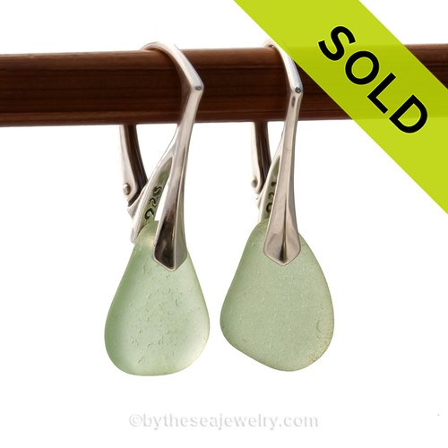 Simple beach found seafoam green Sea Glass Earrings set on top quality solid sterling silver leverbacks. A pair of natural beach found Sea Glass Earrings in a Seafoam Green on Sterling Silver Leverbacks. SOLD - Sorry these Sea Glass Earrings are NO LONGER AVAILABLE!
