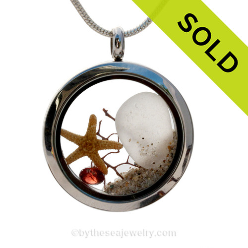 Winter White Sea glass and genuine garnet make this a great locket necklace for the holidays or a January Beach Lover!