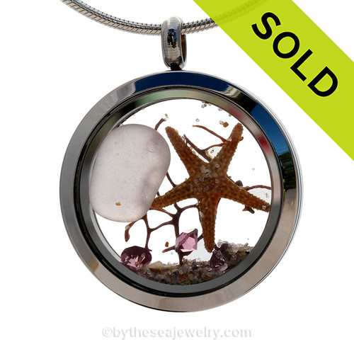 Rare pale purple sea glass combined with beach sand ,a real starfish and brightened up with amethyst crystal gems makes this a great choice for a February Birthday! SOLD - Sorry This Sea Glass Necklace Locket Is NO LONGER AVAILABLE!