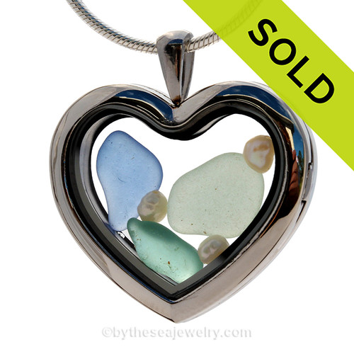 Beautiful pieces of seafoam, aqua and Carolina blue sea glass pieces combined with fresh water pearls in this stainless steel heart locket. SOLD - Sorry This Sea Glass Jewelry Selection Is NO LONGER AVAILABLE!