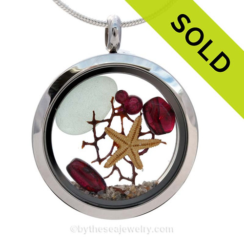 A Beautiful piece of Seafoam green beach found sea glass, a real starfish and genuine garnet gems in a stainless steel locket combined with Genuine Garnet gems. SOLD - Sorry this Sea Glass Locket is NO LONGER AVAILABLE!