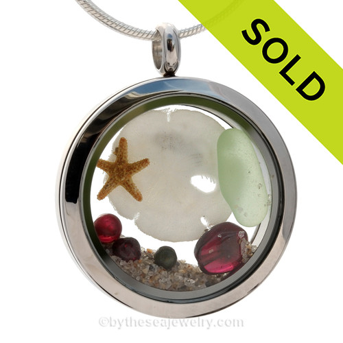 SOLD - Sorry This Sea Glass Jewelry Selection Is NO LONGER AVAILABLE! A small seafoam green beach found sea glass, a real starfish, baby sandollar and genuine garnet gems in a stainless steel locket combined with Genuine Garnet gems.