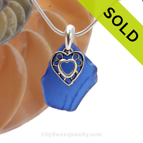 A nice but not perfect piece of blue genuine sea glass with a solid sterling bail and detailed heart charm. This piece comes complete with our sterling 1MM snake chain. SOLD - Sorry this Rare Sea Glass Necklace is NO LONGER AVAILABLE!