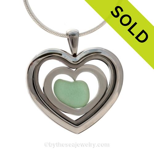 Aqua Green Sea Glass Heart inside a Heart Locket with Stainless Steel Heart.