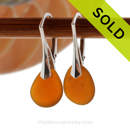 Genuine Amber Brown Sea Glass Earring shaped only by the sea, sand and time are suspended on solid sterling leverback earrings. SOLD - Sorry these Sea Glass Earrings are NO LONGER AVAILABLE!