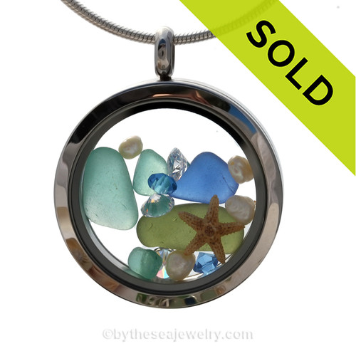 Beautiful pieces of natural cobalt  aqua and green genuine beach found sea glass combined in a stainless steel locket necklace with a real starfish. SOLD - Sorry this Sea Glass Locket is NO LONGER AVAILABLE!