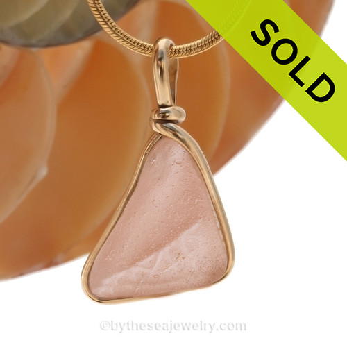 Embossed  peach or pink depression era sea glass set in our classic timeless and versatile Original Wire Bezel© setting in 14K Rolled Gold.