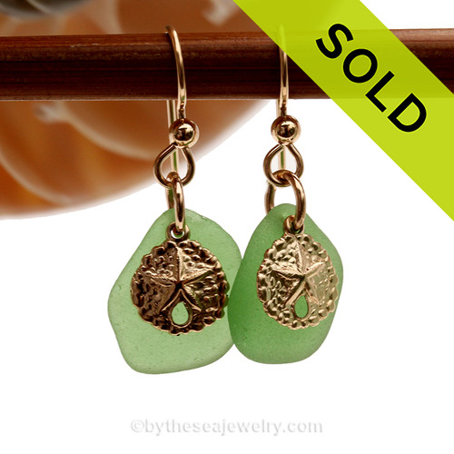 Genuine green sea glass pieces are set with 14K Goldfilled Sandollar charms on professional grade earring wires. SOLD - Sorry these Sea Glass Earrings are NO LONGER AVAILABLE!