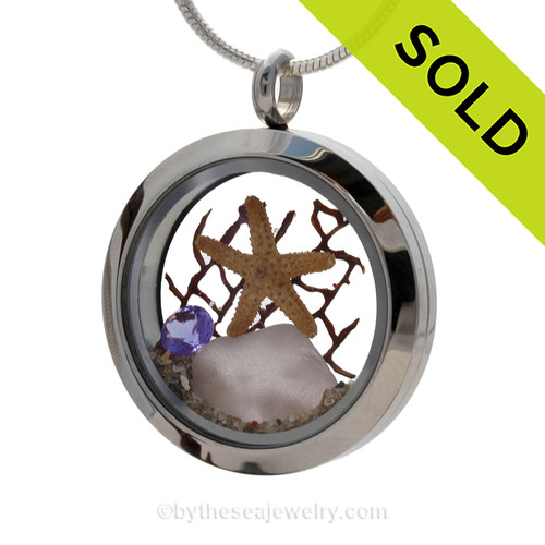 Rare pale purple sea glass heart combined with beach sand ,a real starfish and brightened up with an amethyst crystal gem makes this a great choice for a February Birthday! SOLD - Sorry this Sea Glass Locket is no longer available!