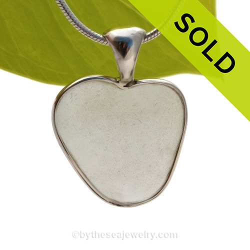 A beautiful White natural sea glass heart set in our deluxe wire bezel pendant setting!  Genuine sea glass hearts are a RARE phenomena and cherished among sea glass lovers! SOLD - Sorry this Rare Sea Glass Pendant is NO LONGER AVAILABLE!