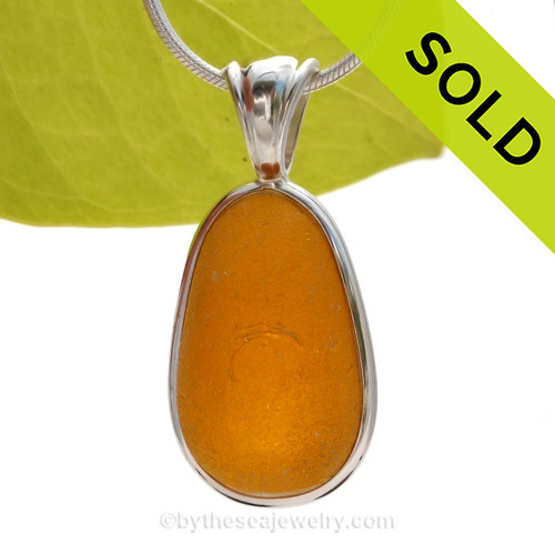 A once in a lifetime piece of large golden ORANGE sea glass is set in our Deluxe Wire Bezel© Sea Glass Pendant setting. AVAILABLE - This is the EXACT Ultra Rare Sea Glass Pendant you will receive
