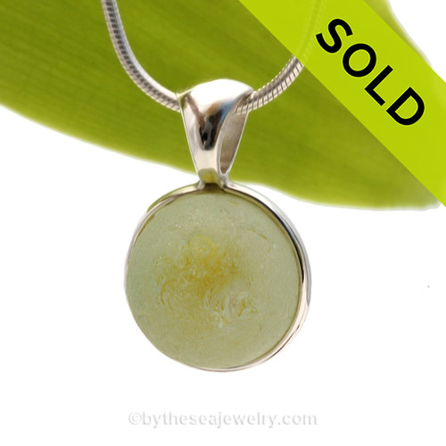 A Genuine Beach Yellow Catseye Found Sea Glass Marble set in our Deluxe Solid Sterling Deluxe Bezel setting. Our Deluxe Wire Bezel© setting combing a sterling bezel wire and cast solid silver bail for a rich elegant look.  SOLD - Sorry this Rare Sea Glass Pendant is NO LONGER AVAILABLE!