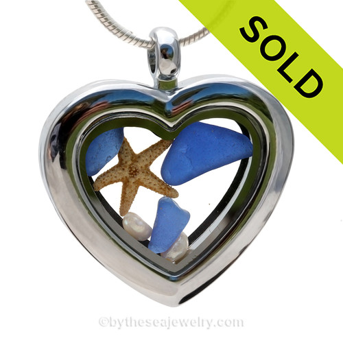 Beautiful pieces cobalt blue sea glass pieces combined with a real starfish and tiny fresh water pearls in this Genuine Sea Glass Heart Locket Necklace. SOLD - Sorry this Sea Glass Locket is NO LONGER AVAILABLE!