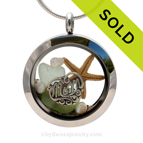 Pieces of genuine sea glass in pale green seafoam , a real baby starfish, genuine fresh water pearls and a solid sterling MOM charm completes this sea glass locket necklace. SOLD - Sorry this Sea Glass Jewelry selection is NO LONGER AVAILABLE!