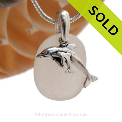 A simple sea inspired Genuine Sea Glass Necklace in Solid Sterling Silver with a Momma and Baby Dolphin Charm. SOLD - Sorry this Sea Glass Necklace is NO LONGER AVAILABLE!