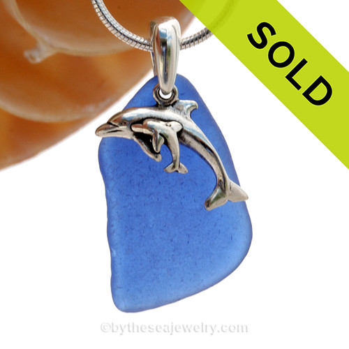 A LARGE and good quality Rare Cobalt Blue beach found sea glass necklace set on a solid sterling cast bail with a sterling silver Momma and Baby Dolphin charm. SOLD - Sorry this Rare Sea Glass Necklace is NO LONGER AVAILABLE!