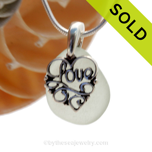 """A nice smaller piece of bright seafoam green genuine sea glass with a solid sterling bail and detailed """"Love"""" heart charm. This piece comes complete with our sterling 1MM snake chain. SOLD - Sorry this Sea Glass Necklace is NO LONGER AVAILABLE!"""